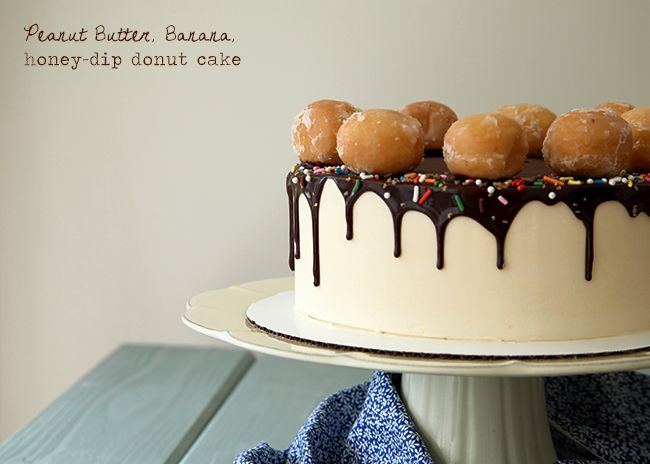Banana cake with peanut butter filling and honey buttercream with honey-dipped donuts and chocolate glaze