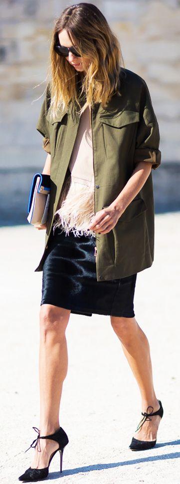 Army jacket, simple top with fringe, black skirt, and black heels