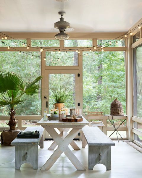 """We eat every meal out here,"" say the owners of the screened-in side porch in this rustic South Carolina getaway. They found the bee skep in an Atlanta garden store."