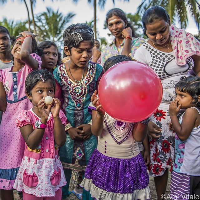 Photo by @amivitale. A contest to see who can blow up the balloon and pop it fastest while celebrating the Thai #Pongal festival in #SriLanka. The festival is a celebration of the Sun God in thanks for a plentiful harvest.  I am currently #onassignment for @natgeo in Sri Lanka.  #southasia #NikonNoFilter #nofilter #nikon #d4s #nikonambassador #amivitale #photojournalism @natgeocreative @thephotosociety @nikonusa #festivals #balloons