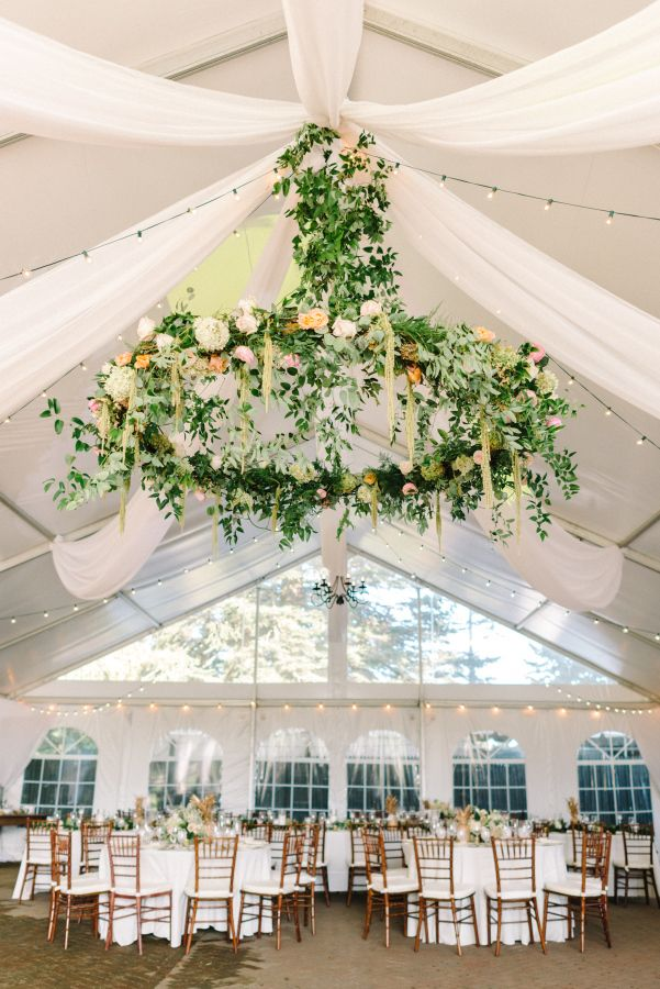 Stunning floral chandelier: http://www.stylemepretty.com/new-jersey-weddings/chesterfield-township-new-jersey/2016/02/02/garden-party-inspired-wedding-infused-with-pineapples/ | Photography: Michelle Lange - http://www.loveandbemarried.com/