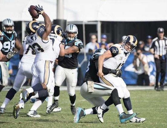 Panthers vs. Rams:  13-10, Panthers  -   Case Keenum, Thomas Davis, Benny Cunningham  -  Rams quarterback Case Keenum fumbles the ball after Panthers linebacker Thomas Davis hit him during the second quarter, but running back Benny Cunningham catches it.