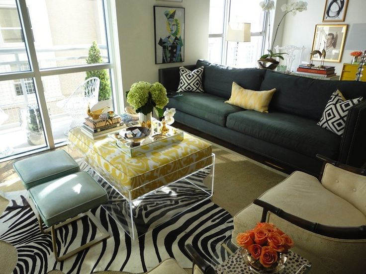 living rooms yellow lumbar ikat pillow zebra cowhide rug layered sisal rug turquoise blue leather ottomans stools lucite ottoman canary yellow ikat