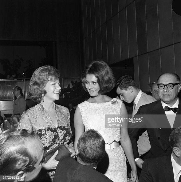 Actress Rita Hayworth, and Academy Award winner, Sophia Loren, are pictured together at a party at the Four Seasons restaurant here, July 25. The party was held to celebrate the success of, Boccaccio 70, which stars Sophia, Romy Schneider, and Anita Ekberg.