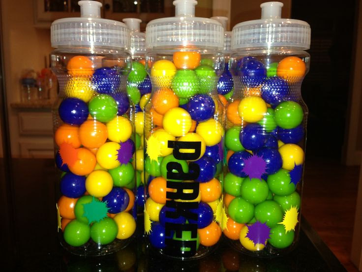 Paintball party favors! Sports water bottle with name and paint splatters filled with gum balls!! Www.perfectlypersonalizedmonograms.com