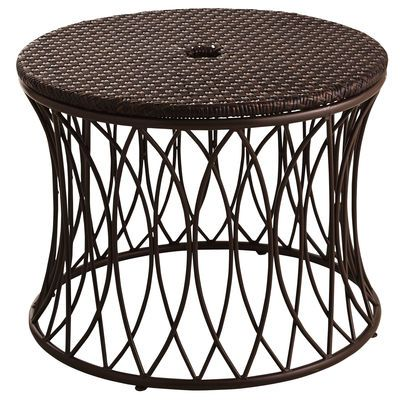 this decorative low table provides extra stability and style for your patio umbrella simply place over your existing stand and insert the umbrella down