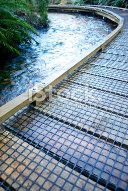 Boardwalk across River, New Zealand. Low Angle View. Royalty Free Stock Photo