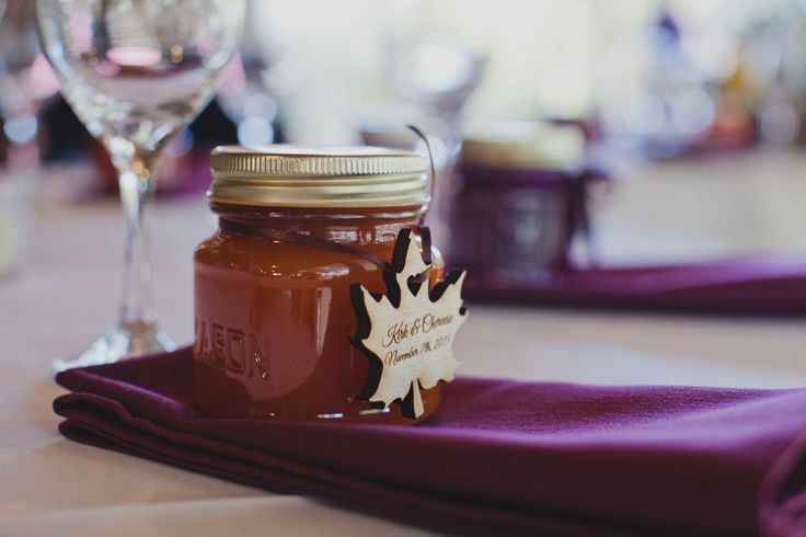 Jars of jam with wooden maple leaf wedding favor