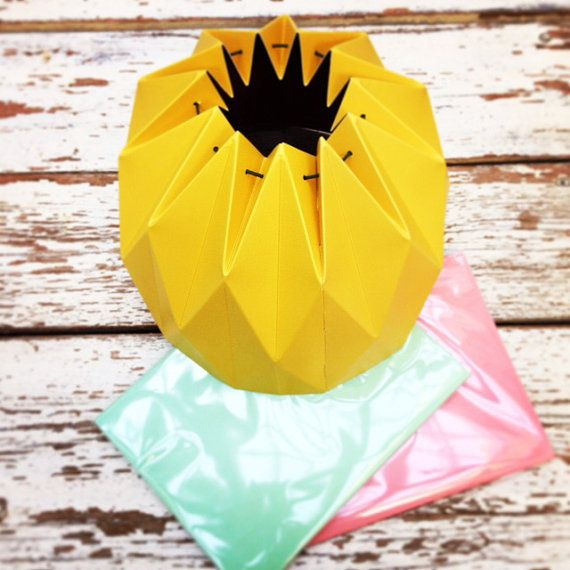 A beautiful origami pendent lampshade. It comes in six different colors: Aqua, Yellow, Light Pink, Fuchsia, Grey or Turquoise.  The lampshade