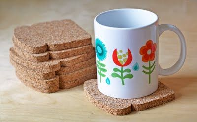 These coasters are darling, and would be pretty simple to make from a sheet of cork.