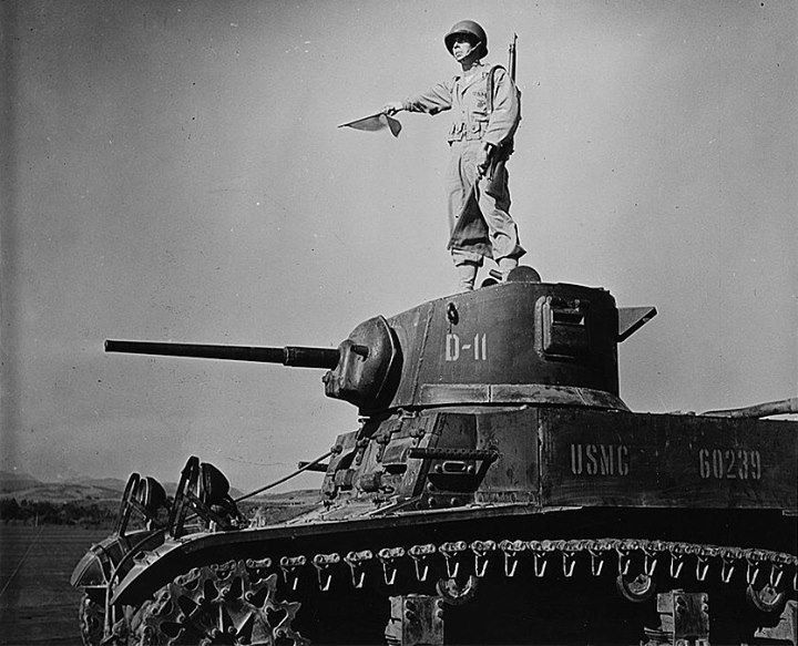 US Marine Corps signalman atop a M3 Stuart light tank during an exercise in the United States 1942.