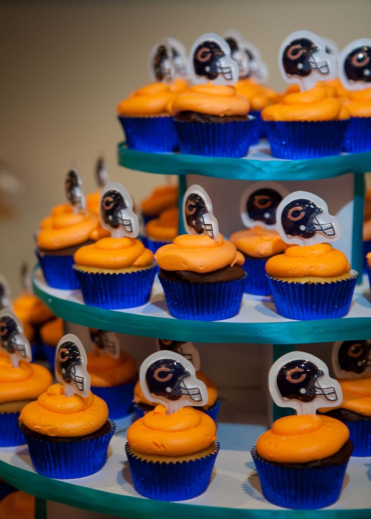 cupcakes with orange frosting in blue liner.  chicago bears emblem.    borterwagner photography    borterwagner.com