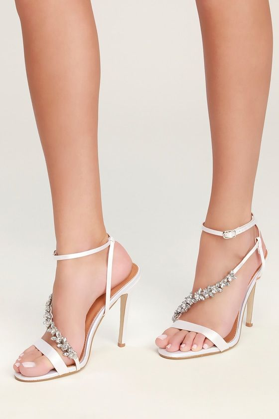 1947bb70ab9e3d The Harlene Ivory Satin Rhinestone Heels are RSVP ready! Luxe satin fabric  forms these stunning heels with a minimal strappy silhouette