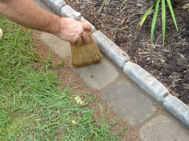 Edging a Flower Bed With Cement Pavers. (Note I pinned