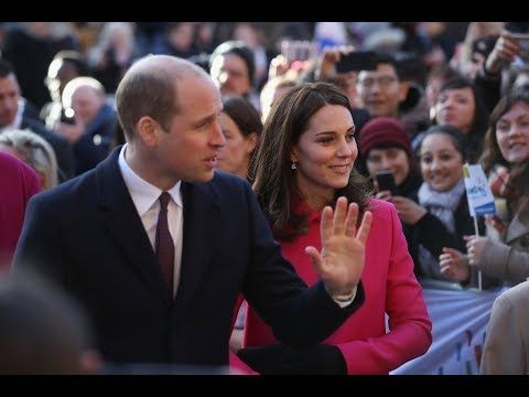 Pink for a girl? Pregnant Kate in a cerise Mulberry coat on a visit to C...