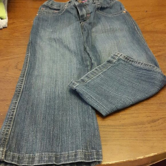 Boot cut jeans Girls jeans with pink buttons on back pockets Wrangler Pants