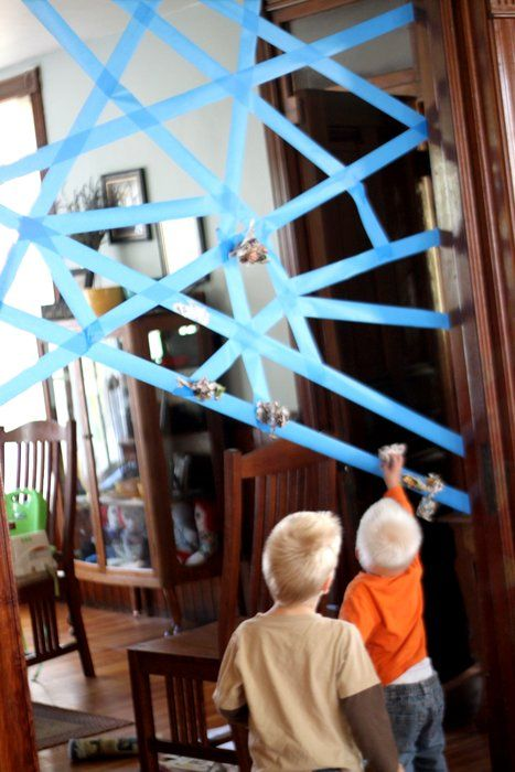 Sticky spider web - roll up pieces of paper then throw at the sticky spider web. Great idea for indoor fun! #Schwans #SnowedIn #RainyDay #kids