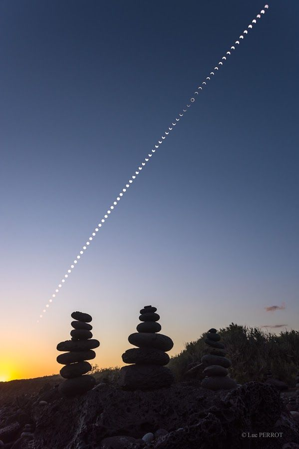 September's eclipse of the Sun is documented in the 68 frames of this timelapse composite. Starting at 1pm local time a frame every 4 minutes follow's the progress of the New Moon across the solar disk. Taken near the centerline of the narrow eclipse path, the series of exposures ends with a golden sunset. Balanced rock cairns in the foreground line a beach on the southern side of Reunion Island in the Indian Ocean, near the village of Etang-Salé.
