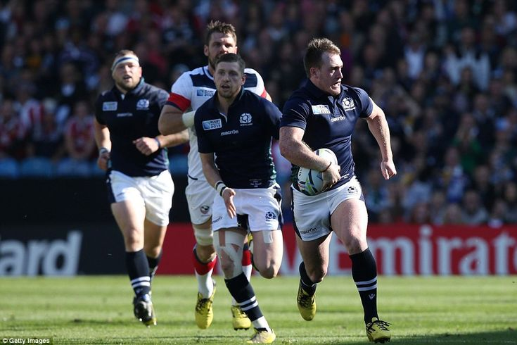 Scotland full-back Stuart Hogg (right) breaks clear with the ball during Scotland's victory over USA at Elland Road Leeds on Saturday.......showed them how it was done.........36-16