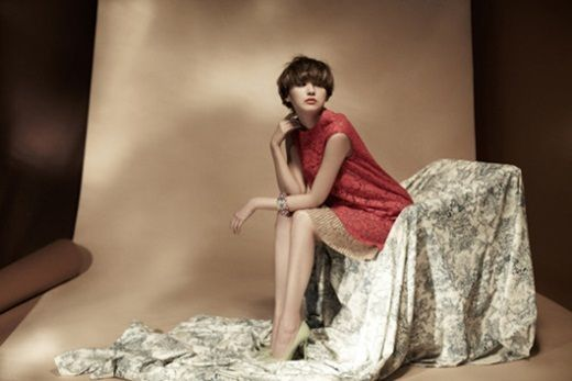 Yoo In-young strikes a pose in the studio in here pretty little dress.