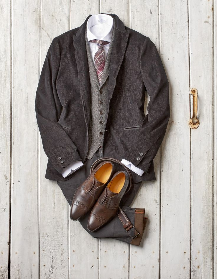 Corduroy Wire Trim Jacket: John Varvatos Collection ($1298) - made in italy Herringbone Wool Vest: John Varvatos Star USA ($250) - made in china Wool/Silk Tie: Eton ($128) - made in italy Tonal Paisley Shirt: Signum ($150) - made in poland Contrast Weft Stretch Denim: Alberto ($238) - made in tunisia Brogued Belt: Boss ($225) - made in italy Brogued Cap Toe Shoes: Giulio Moretti ($398) - made in italy