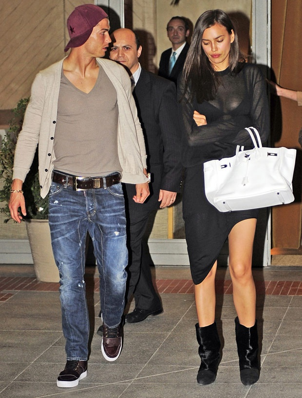 Irina looks unimpressed - possibly with Cristiano Ronaldo's baseball cap