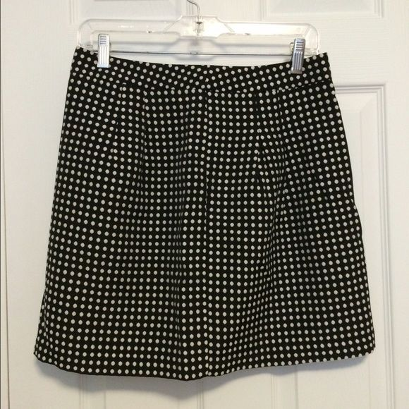 The Limited Polka Dot Black White Pleated Skirt Very cute versatile skirt that could be worn for a date night or worn to work Material: 68% polyester, 32% cotton lining: 100% polyester zips up the back length: 17.5 inches The Limited Skirts