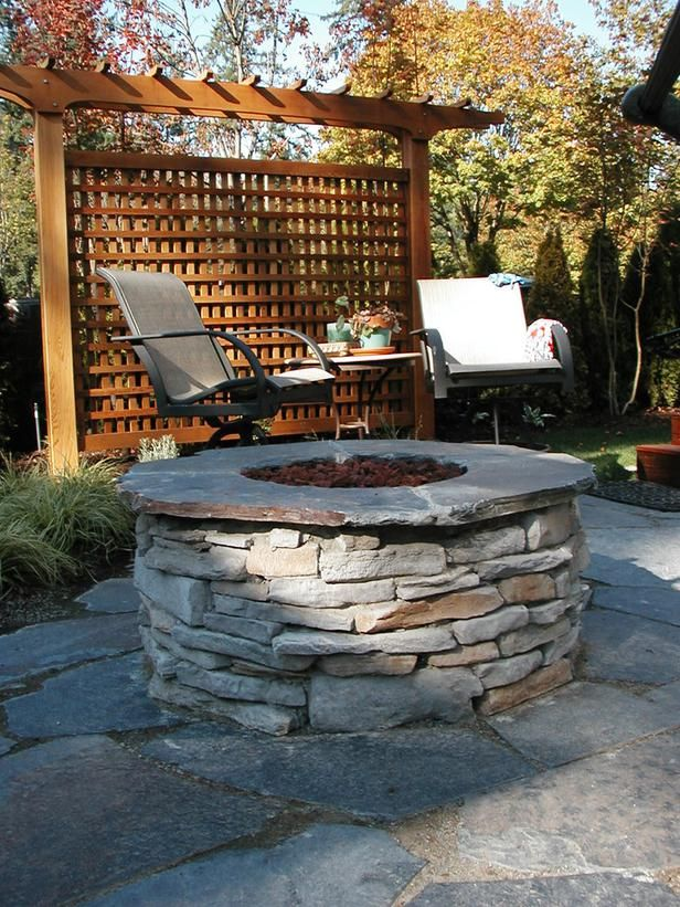 Cozy Fire Pit: This back garden getaway includes privacy screens, a flagstone patio and a gas fire pit. From HGTV.com's Garden Galleries