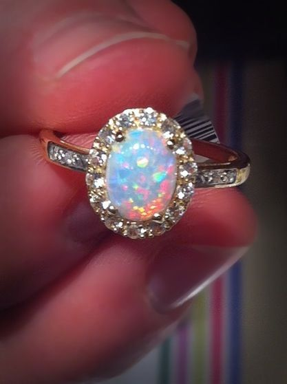 Promise ring<3i would love this. my birth stone and diamonds :D
