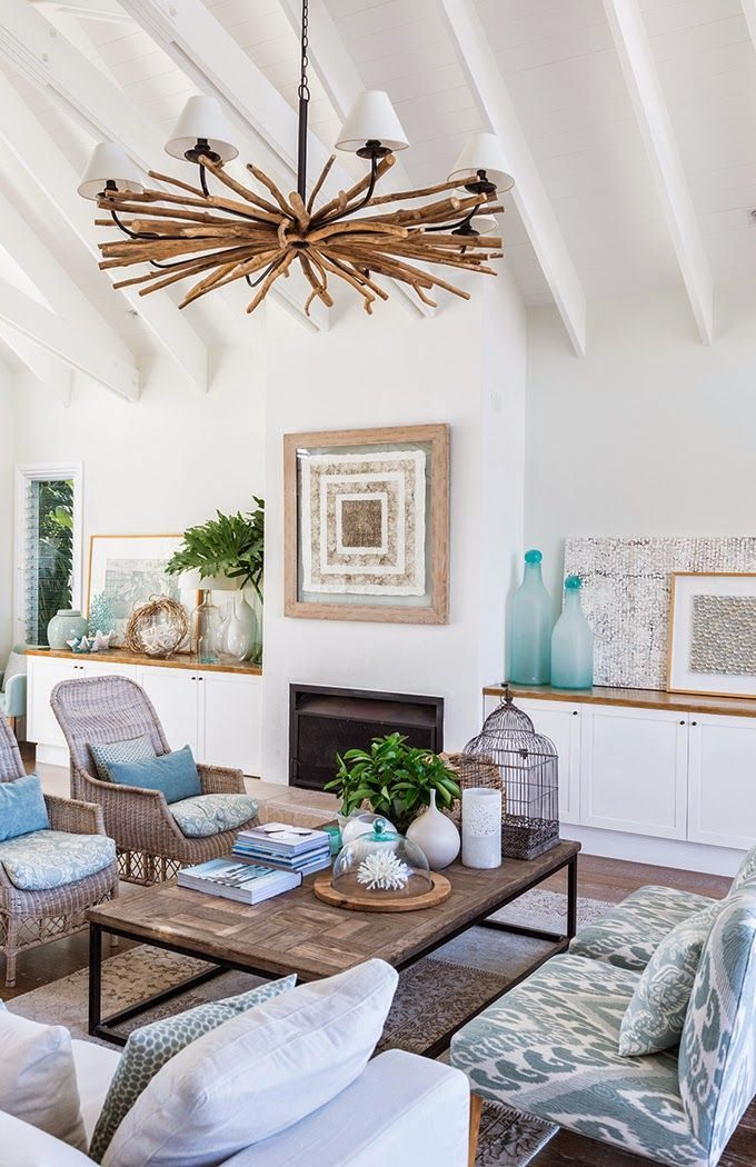 Same home, different view. Coastal living room. Lots to like. Especially the furniture and built-in cabinets on either side of the fireplace, although I wouldn't choose that chandelier (too rustic for me). I would add a shade of aqua/sea glass or turquoise paint to the walls. House of Turquoise.