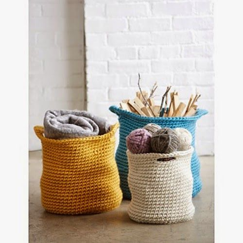 Contain your clutter in these stylish crochet baskets. A free pattern download found at Yarnspiration.