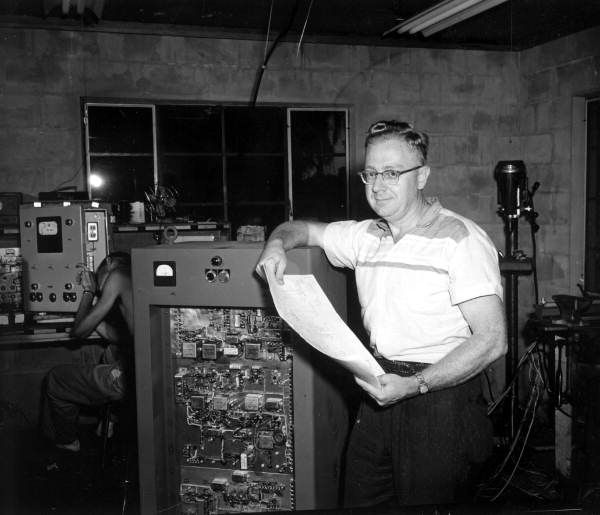 Director of Research Carl Vossberg stands by an apparatus in the laboratory of The Electron-Machine Corporation - Umatilla, Florida