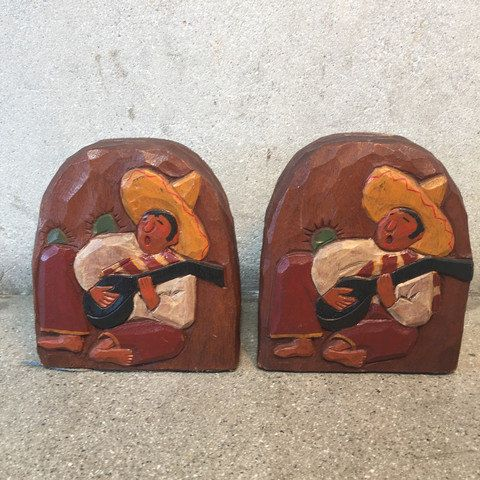 This listing is for vintage bookends with a Mexican Folk Art design. They are made by Laguna Craftsmen in Laguna Beach, California in late 1930s from the time when Monetery Furniture was all the rage in California. These bookends are wood. They are in beautiful condition and have the original label from Laguna Craftsmen. size : 6.25 x 5 x 5 THANK YOU FOR VIEWING OUR LISTING.... Visit our Etsy Shop: www.etsy.com/shop/UrbanAmericana  Visit our website: www.urbanamericana.com  Follow us…