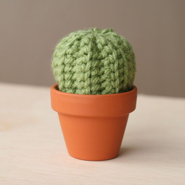 This little echinocactus grusonii cactus is quick to make and, I think, adorable. I used a 3.5mm hook (size E) with Impeccable Worsted yarn in Fern (from Michaels), but any greenish yarn will work....