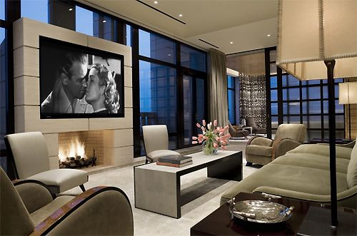 Love the focal wall with the screen placement, and windows surrounding the screen. Very modern.