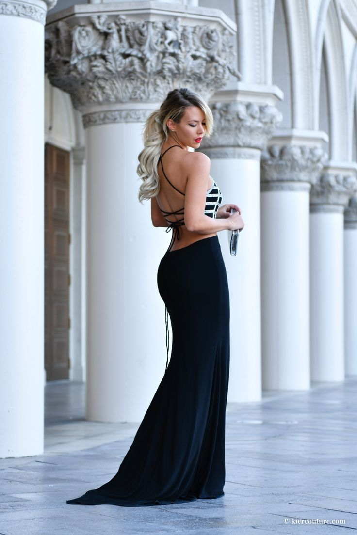 Lace up crystal black gown on Kier Mellour in Las Vegas at the Venetian in Alyce Paris backless mermaid gown and faux fur coat with Bellami hair in Ash blonde pony tail