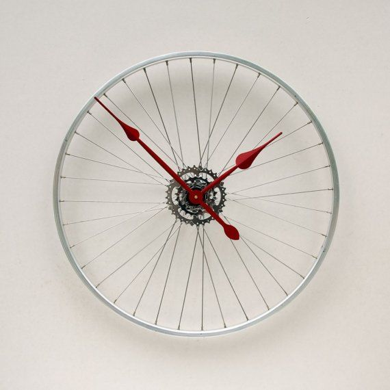 This clock was made from a recycled aluminum bike wheel. The wheel mounts directly to the wall through the hub using a hollow wall anchor and gives the
