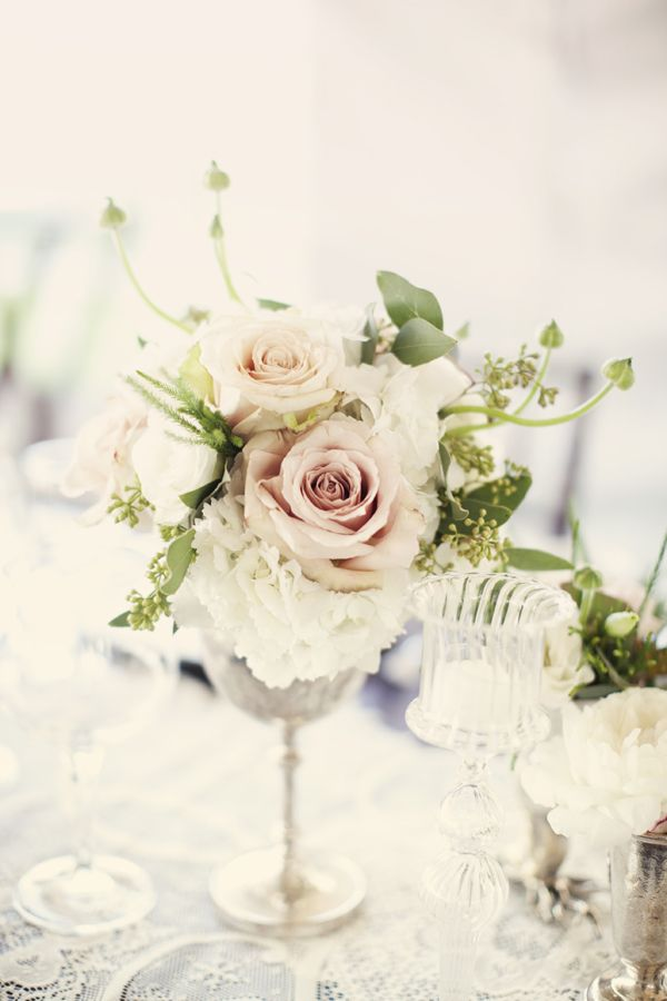 white florals in crystals or glass containers with hint of soft colors like dusty rose or blush colored florals