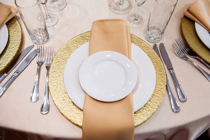 Place setting with Gold charger plate and champagne napkin