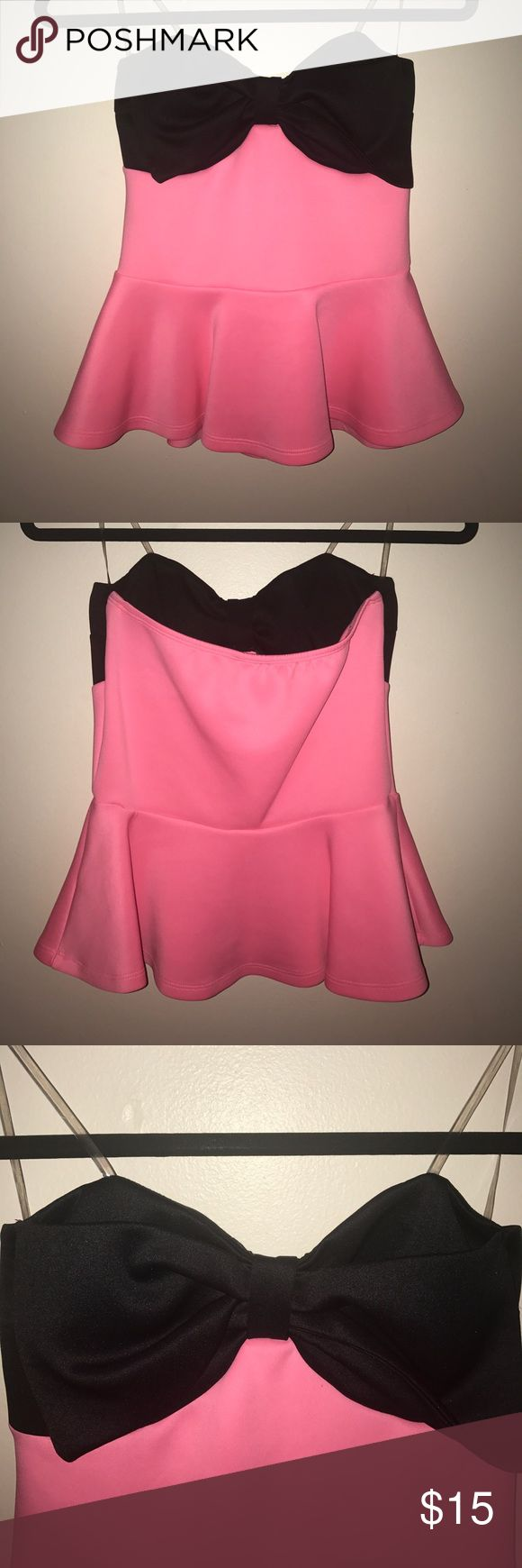 Sleeveless Pink and Black Peplum Top Sleeveless, pink peplum top with a black bow at the top. Great material. Society Girl Tops