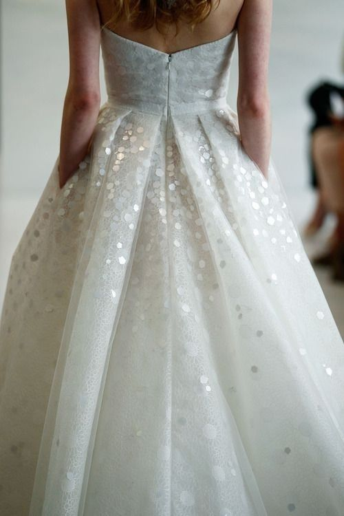 The way the chunky sequins look like sparkly snow. | 50 Gorgeous Wedding Dress Details That Are Utterly To Die For