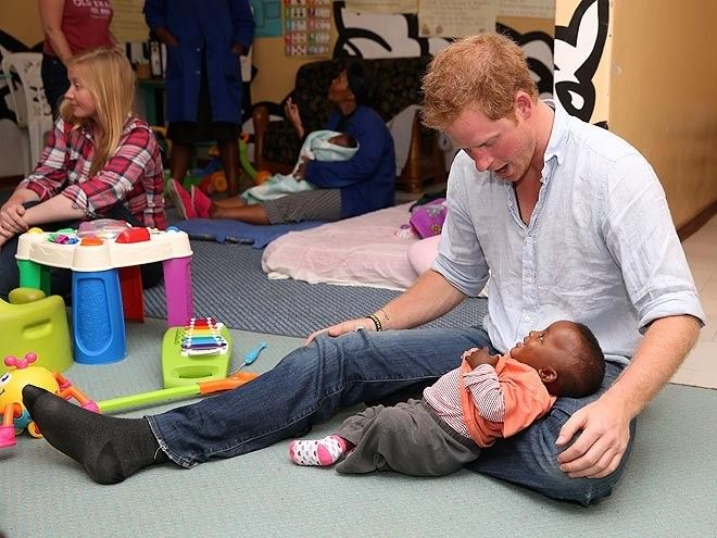 "LAP IT UP Therapy time with Harry? The prince gives one small guy a place to rest his head during a Dec. 8 stop by the malnourishment program Touching Tiny Lives. ""There were 12 malnourished babies under the age of 5 that we were fortunate enough to play with for an hour,"" Harry writes."