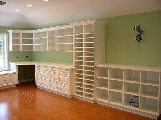 Love all of the built in shelves. Would possibly turn some of those shelves to cabinets to hide some of the creativity, but maybe not.