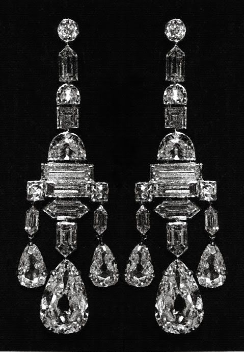 CARTIER The original owner of these magnificent earrings was the Honorable Mrs. Ronald Greville who asked Cartier to create the pair using every conceivable cut of diamond. In 1918, Cartier presented Mrs. Greville with the earring sans the six large pear-shaped drops. In 1922, the jewelers are Cartier added the drops, giving the finished product an astonishing variety of modern diamond cuts: half moon, trapeze, square, pear, baguette and emerald.    Stalking the Belle Époque: Gifts of…