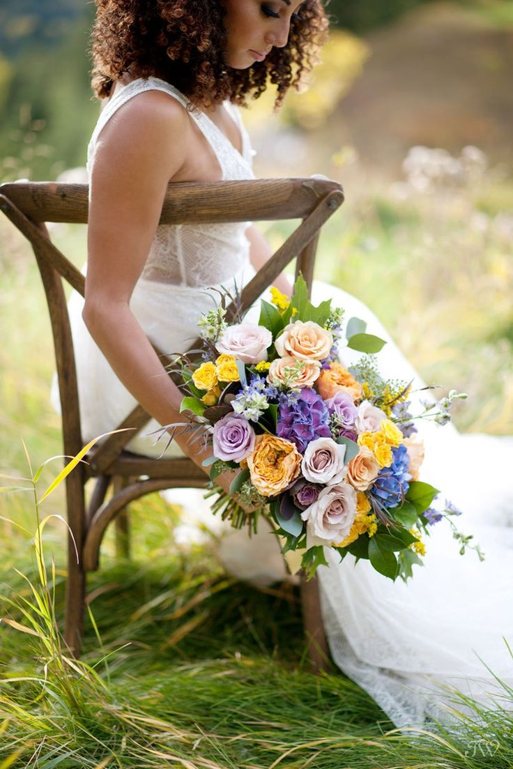 fall bride with her bouquet at a Silvertip wedding captured by Calgary wedding photographer Tara Whittaker | Bouquet from Flowers by Janie