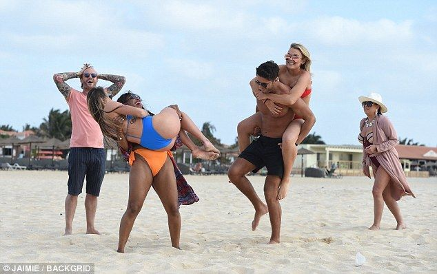 Tallia Storm gets a piggyback from Mike Thalassitis  Shes said to have been romancing Muggy Mike Thalassitis during their time together on Celebs Go Dating.  And Tallia Storm certainly seemed very comfortable with the Cypriot footballer as the stars larked around the beach on location in Cape Verde.  Clad in a skimpy red bikini the Scottish singer 19 showed off her sensational figure as she jumped on the back of shirtless hunk Mike for a piggyback ride.  Fun in the sun: Tallia Storm and…