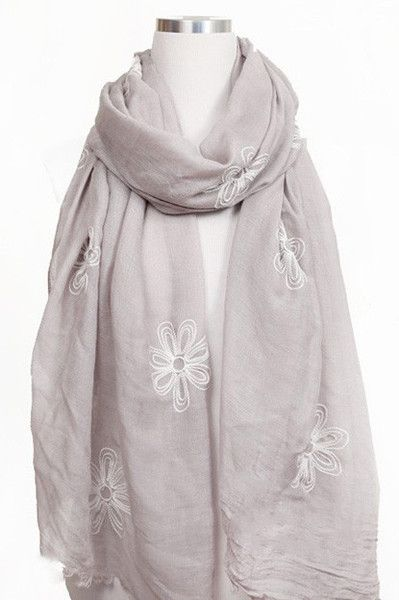 """This great floral embellished scarf is a delicate and very versatile piece and definitely a must have. 30% VISCOSE 70% POLYESTER71""""L X 28""""W"""