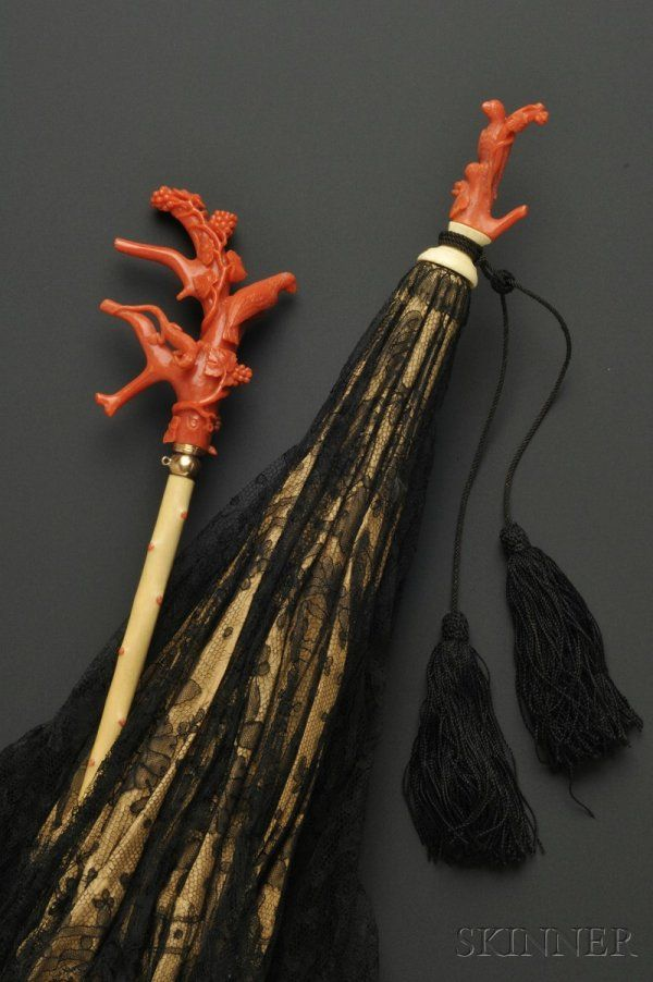 Cazal parasol with coral handle, black chantilly lace cover and tassle, mid-late 1870's