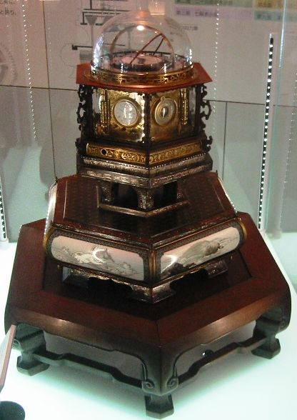 Designed by the Japanese inventor Hisashige Tanaka about a decade after the first Western mechanical clock was invented, The Myriad Year Clock, also known as the Ten Thousand Year Self-Ringing Bell. This piece of the later Edo period is a sophisticated time coordination device and belongs to the category of Japanese clocks called Wadokei. Designated as an Important Cultural Asset by the Japanese government...