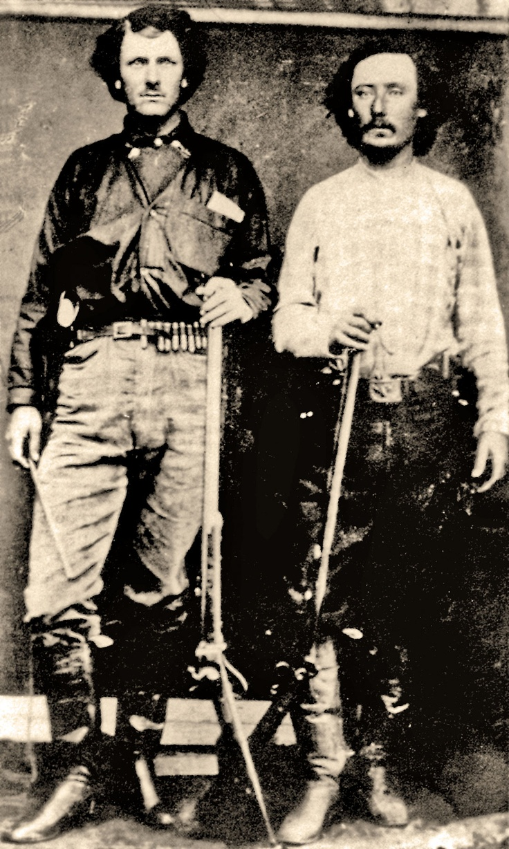 BILL TILGHMAN — Shown here in his buffalo hunting days, Bill Tilghman (at left) was approached by Bat Masterson to serve as a deputy sheriff from 1878, a job he served admirably until 1884, which earned him the respect to work in various law enforcement jobs for the rest of his life. He's best known for single-handedly capturing Bill Doolin in 1895. He also rose to fame as part of the